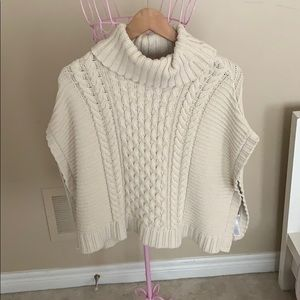 Children's knitted poncho. Brand new never worn